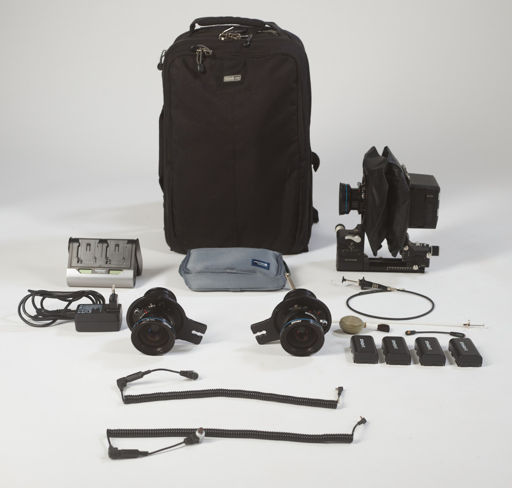 Camera gear arranged in front of a camera bag
